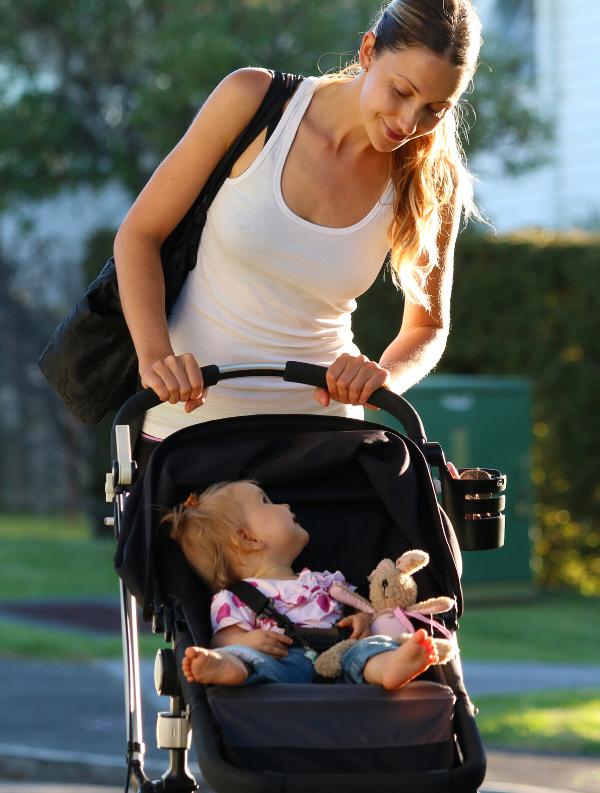 Woman walking baby in stroller