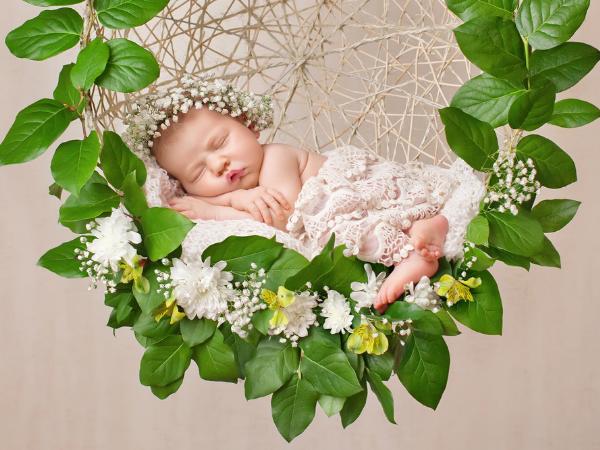 Newborn in fancy clothes