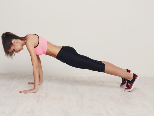 woman doing a regular plank for a beginner plank challenge